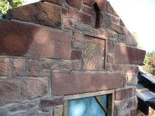 Random red sandstone walling